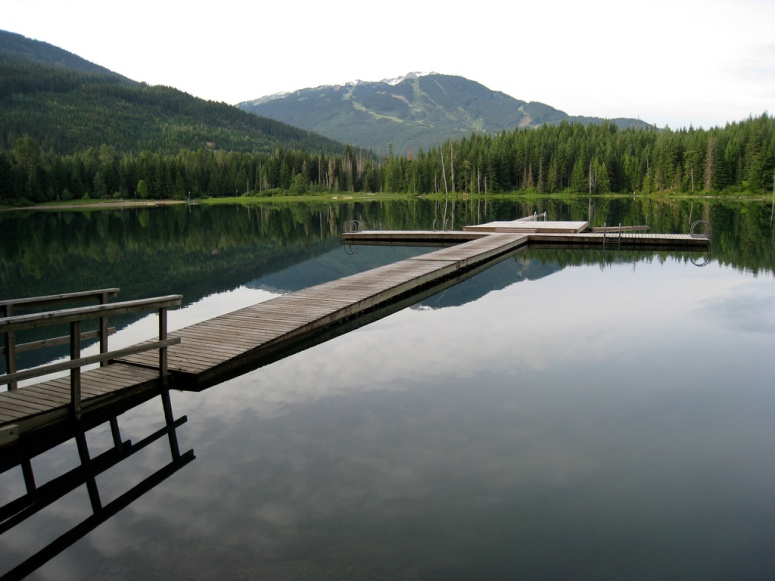 Lost Lake !  This floating dock on Lost lake is used by naturists for clothing-optional sunbathing and skinny-dipiping during summers at Whistler.